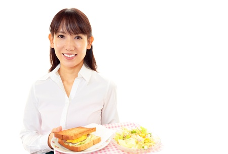Smiling waitress carrying a meal photo