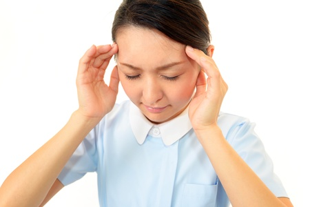 The nurse who is troubled with a headache photo