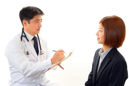 Smiling Asian medical doctor photo