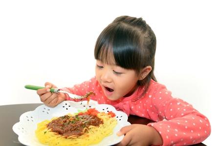 Child eating spaghetti photo