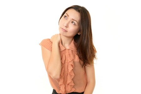 Tired and stressed young asian woman Stock Photo - 17509373