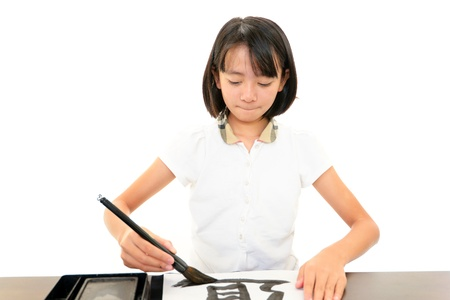 The girl who does calligraphy Stock Photo