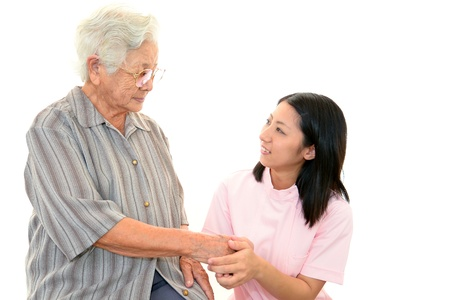 The elderly and the care person who smile 免版税图像