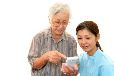 frailty: The elderly and the care person who smile Stock Photo