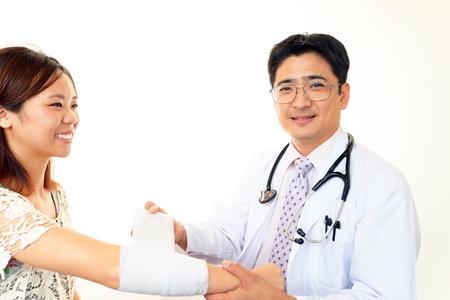injure: Smiling asian medical doctor