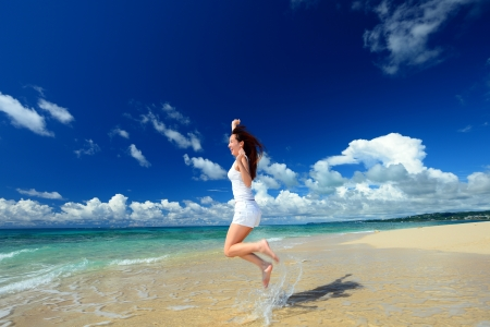 young woman on the beach enjoy sunlight Stock Photo - 17560818