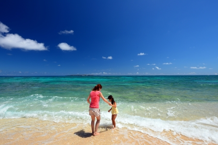 Family playing on the beach in Okinawa Stock Photo - 17560827