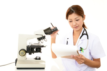 Doctor with a microscopic examination Stock Photo - 17619954