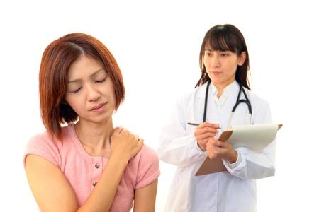 Orthopedic surgeon with a medical examination photo