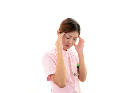 The nurse who suffers from a headache Stock Photo - 17686513