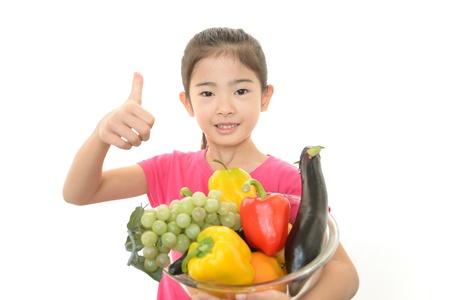 Girl having vegetables photo