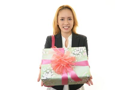 Smiling business woman with a gift Stock Photo - 17763914