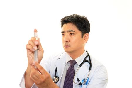 meningococcal: Doctor en medicina asi�tica Foto de archivo