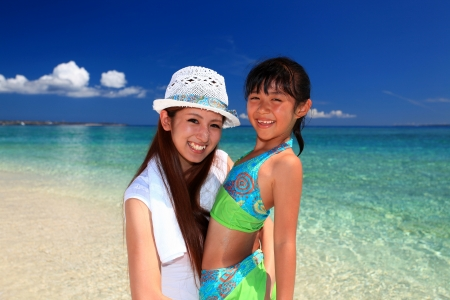 Family playing on the beach in Okinawa Stock Photo - 18024005