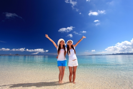 young women on the beach enjoy sunlight photo