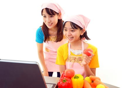 Parent and child who enjoy cooking photo