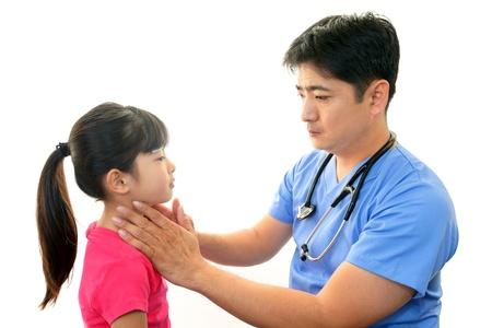 rubella: Doctor examining a patient