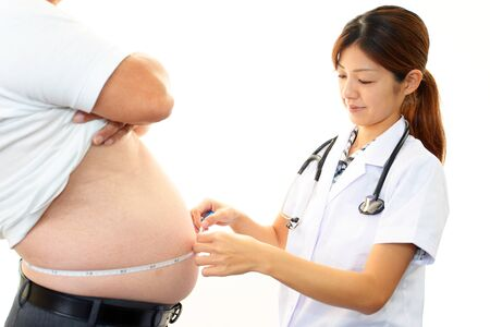 Woman doctor with a medical examination in obese patients photo