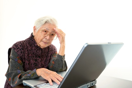 Senior woman with a notebook Stock Photo - 18476039
