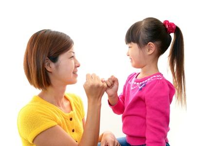 アジアの女の子は幸せな微笑を浮かべた 写真素材
