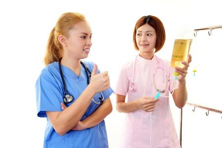enteritis: Smiling  Asian medical doctor Stock Photo