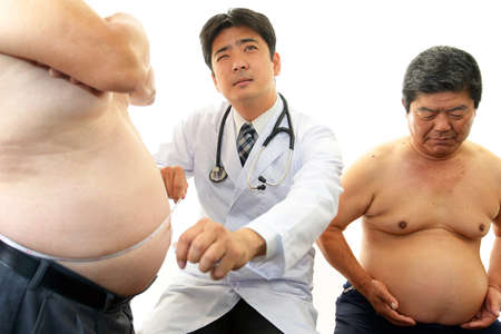 serious doctor: Serious doctor examining a patient obesity