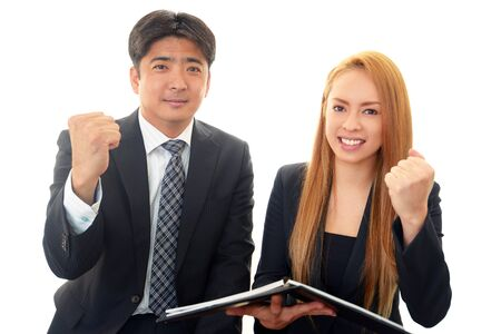 A businessman and the office lady who smile photo