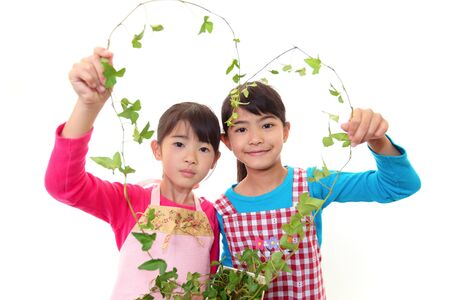 asian house plants: The girls who takes care of a plants