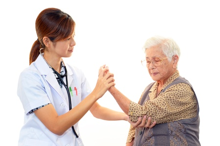 frailty: Doctor examining a patient