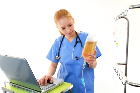 enteritis: Doctor working at the PC Stock Photo