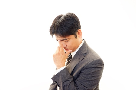 Tired and stressed Asian businessman  Stock Photo - 18788367