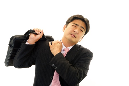 Tired and stressed Asian businessman  photo