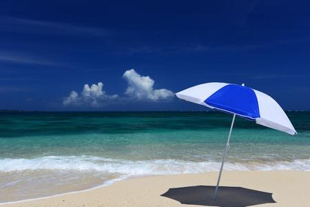 summery: The beach and the beach umbrella of midsummer