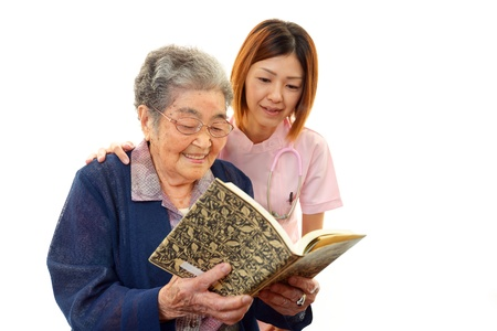 An elderly lady and nurse of the smile