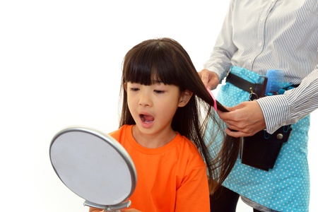Haircutting girl in the hairdressing saloon photo