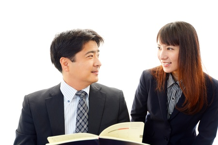 A businessman and the office lady who confirm documents  photo