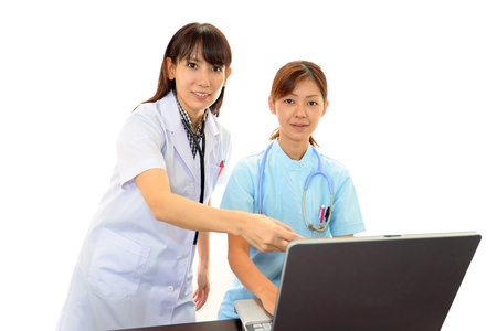 Smiling  Asian medical doctor Stock Photo - 18987540
