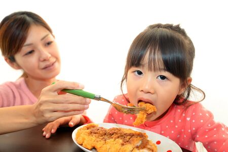 Parent and child who enjoy a meal photo