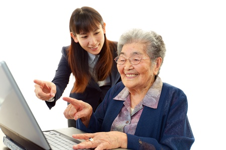 Teacher helping students on the computer