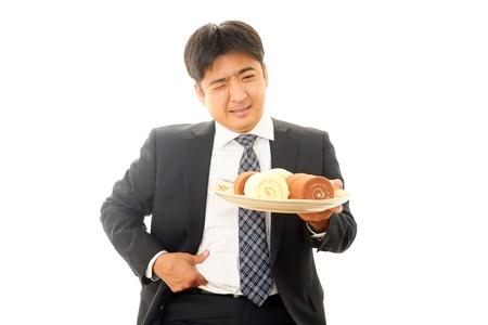 pay cuts: Weight-watching man Stock Photo