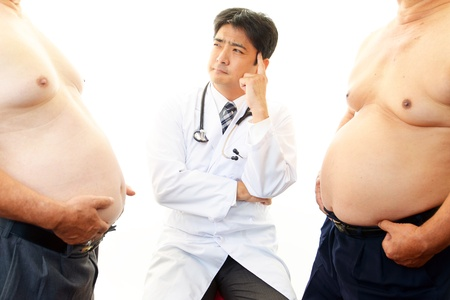 Serious doctor examining a patient obesity