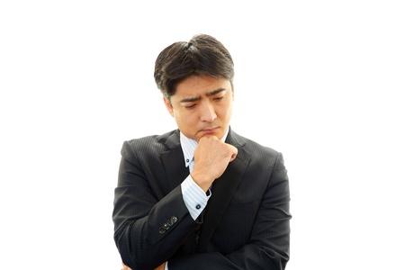 Expression of melancholy businessman