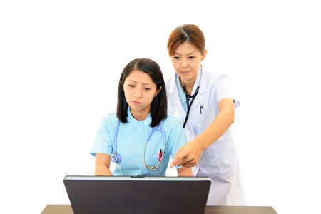 A doctor discussing a patient chart with nurse photo