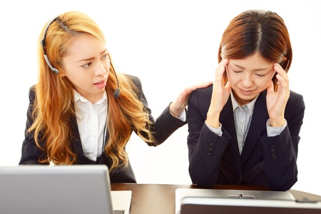 trouble free: Two of the career woman of uneasy look Stock Photo