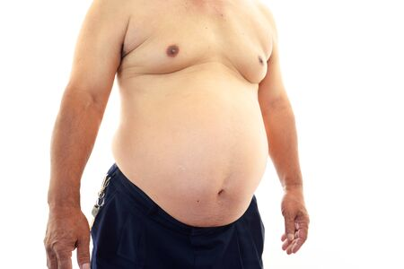 relaxed business man: The obesity man who is worried about a stomach Stock Photo