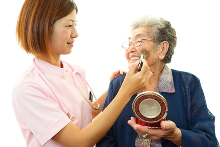 Senior woman with her home caregiver Stock Photo