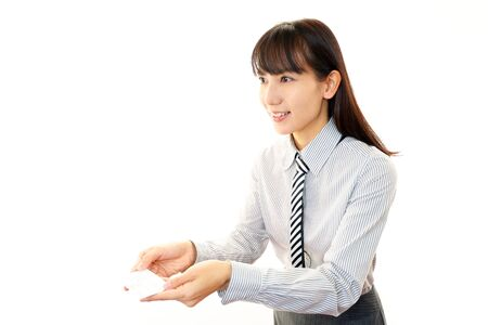 Smiling woman with business card photo