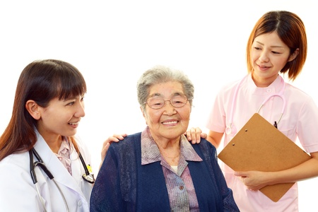 Antiguo wonan y el personal m?dico de la sonrisa Foto de archivo