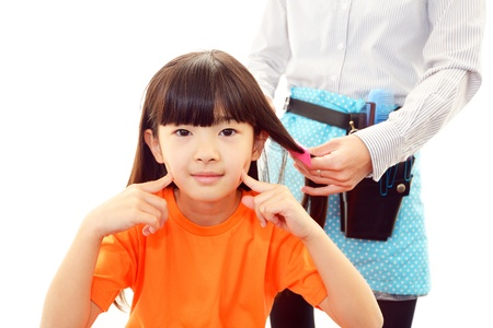 haircutting: Haircutting girl in the hairdressing saloon
