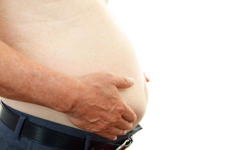 metabolic: The obesity man who is worried about a stomach Stock Photo